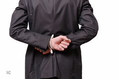 A businessman is tied with a usb cable (Vincent Guérault) Tags: men businessman shirt wire technology working cable business suit usb disabled tied youngadult bound attached connection restrained cuffed impairment businessperson electronicsindustry unabled