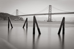 San Francisco's Bay Bridge (Pat Charles) Tags: ocean california longexposure bridge water bay blackwhite nikon suspension span greatphotographers nikonflickrawardgold nikonflickrawardplatinum mygearandme mygearandmepremium mygearandmebronze mygearandmesilver mygearandmegold mygearandmeplatinum mygearandmediamond ringexcellence dblringexcellence tplringexcellence eltringexcellence