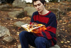 (Snippets Of Serenity) Tags: autumn light portrait man guy fall nature canon fire 50mm book woods burn rebelt2i