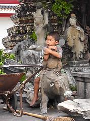 boy (Zvetkova) Tags: travel boy statue thailand buffalo nikon waiting southeastasia sitting bangkok