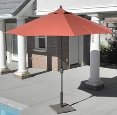 sunbrella_patio_umbrella_brick (seosuvankar) Tags: patio umbrellas