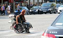 Homeless Gypsy Woman crossing Champs-Élysées (Jonno Cass) Tags: paris france lady bag one wheelchair homeless leg champs portfolio gypsy amputee