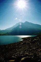 Lac du Mont-Cenis (_Kry_) Tags: mountain scree stones light sun lake mountains sky highaltitude