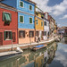 Colorful houses alongside canal in Burano