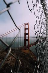 This city (vvnnie) Tags: landscape san francisco vertical bridge golden gate overcast weather fence window hole view travel california coast architecture