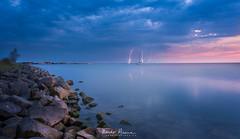 strike! #lightning #water #markermeer #sunset #clouds #weather #stones