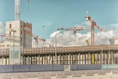 Becoming Different 2 (pni) Tags: crane constructionsite redi sky cloud concrete trafficbarrier pole street lamp lamppost fence kalasatama helsinki helsingfors finland suomi pekkanikrus skrubu pni fiskehamnen