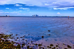 View of the skyline of Tampa, Florida, U.S.A. from a distance (Jorge Marco Molina) Tags: panoramic tampa florida usa downtown skyline centralbusinessdistrict tampabay hillsboroughcounty water bay sunshinestate urban skyscraper building architecture realestate cosmopolitan metro metropolitan metropolis city cityscape density longexposure 10stopfilter
