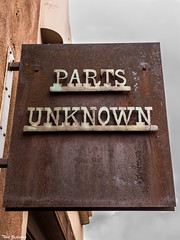 PARTS UNKNOWN (Thad Zajdowicz) Tags: sign type text writing letters words signboard santafe newmexico zajdowicz leica lightroom availablelight outdoor outside metal iron rust oxidation corrosion aged weathered