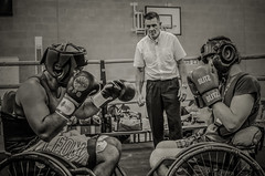 Adaptive Boxing - Team Italia vs Team UK (sophie_merlo) Tags: wheelchair wheelchairsport wheelchairsports adaptivesport adaptiveboxing wheelchairboxing boxing sport sports bw mono monochrome noir documentary photojournalism disablity disabled disabledathlete paralympic chance fight warriors fighters disabledfighters blackandwhite action ring amputee amputees courage
