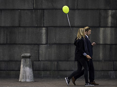 Nobody can be uncheered with a balloon. (Markus Jansson) Tags: balloon street candid yellow stockholm oldtown gamlastan streetphotography couple walking