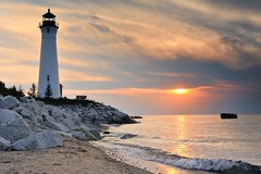 Crisp Point Lighthouse Sunset - Lake Superior, Upper Michigan (Michigan Nut) Tags: sunset sky usa lighthouse reflection beach nature clouds landscape midwest waves michigan scenic landmark historic nautical lakesuperior uppermichigan crisppointlighthouse
