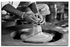 Potter (Aithal's) Tags: blackandwhite white black monochrome composition digital canon creativity eos rebel 50mm potter canon50mmf18 f18 canoneos xsi mangalore murali 50f18 pilikula 450d canon450d aithal canonrebelxsi rebelxsi canondigitalrebelxsi aithals wwwmuraliaithalcom pilikulaartisansvillage