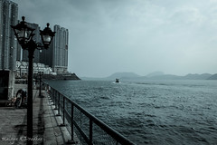 A quiet moment between worlds (Malaya K Pradhan) Tags: sea seascape water canon hongkong boat waterfront pokfulam canon500d waterbody pregamewinner malayapradhan malayakpradhan hongkongseascape pokfulamwaterfront