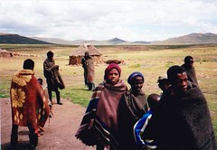 Lesotho, South Africa 2000 001 (Dorsetized) Tags: family friends sky happy clothing village african patterns group hats tribal huts together traditionaldress undeveloped contented localcustom remotelandscape unhurriedlfestyle