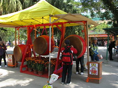 Beating the prayer drums (oldandsolo) Tags: china hk hongkong buddhism bigbuddha lantauisland polinmonastery chinesetemple chineseculture ngongping tiantanbuddha ngongpingbuddha prayerdrums buddhistfaith chinesereligiousshrine largestseatedbronzebuddha