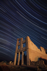 Rhyolite Startrails (Luke Hertzfeld) Tags: park morning building night landscape outdoors desert nevada bank ghosttown environment deathvalley rhyolite heavens beatty celestial startrails bullfrog longexposures cookbank