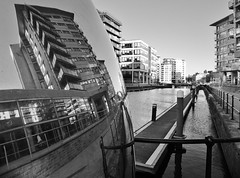 Clarence Dock in a shiny ball B&W (jasonmgabriel) Tags: city sky bw white black west reflection water sunrise ball buildings river dock apartment jetty yorkshire leeds blocks railings aire clarence barges