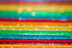 Stripes (Photoshoparama - Dan) Tags: blue red orange macro green colors yellow glitter rainbow bokeh stripes swizzlesticks strobist macromonday photoshoparama danielejohnson cocktailstirers dej5022