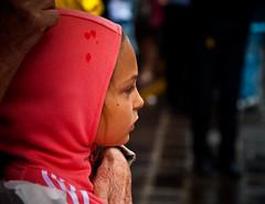 < It's raining > (pigianca) Tags: italia toscana casteldelpiano presentazionepaliodicasteldelpiano ritratto bambina pioggia italy tuscany presentationpalioofcasteldelpiano portrait child rain candidportrait streetphoto nikon d700 nikkor24120f4