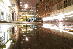 twentyfour hours (maybemaq) Tags: street uk england urban reflection london water car rain coral shop wall night contrast speed underground puddle lights mirror calle store lowlight alley exposure strada fitzrovia traffic camino britain geometry taxi tube perspective double structure symmetry backstreet line september beam citylights midnight tubestation lighttrails walls atm reflexions aftertherain recent nonstop conveniencestore cashpoint 24hours waterreflection lowangle warrenstreet rainydays twentyfour lightstream wetreflection twentyfourhours maybemaq blinkagain