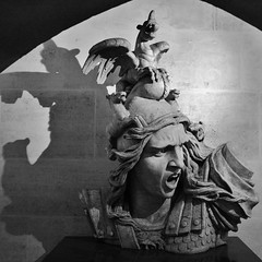 Triomphe bust (sonofwalrus) Tags: blackandwhite bw sculpture paris france slr face canon dragons bust arcdetriomphe eos400d
