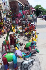 iron menagerie (BarryFackler) Tags: omaha vacation nebraska 2016 omahanebraska midwest omahane oldmarket outdoor irondecorandmore mexicanimports store retail sidewalk gardensculptures elephants frogs sunflowers colors colorful kitsch kitschy tacky iron craft art shop shopping barryfackler barronfackler giraffe