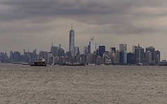 NYC Skyline and Panoramic Perspective Of NY Harbor (nrhodesphotos(the_eye_of_the_moment)) Tags: dsc02608160 wwwflickrcomphotostheeyeofthemoment nrhodesphotosyahoocom nyharbor lighthouse waterfront panoramic perspective manhattan skyline skyscrapers window metal glass spires wtc nyc clouds sky outdoor season summertime