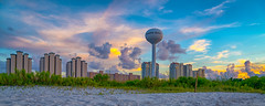 Condos Of The Beach (Stuart Schaefer Photography) Tags: watertower cloudscape sunset sonya7rm2 condos bay navarrebeach buildings seascape landscape outdoor clouds skyline sky