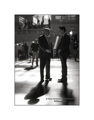 nyc#87 - The Meeting In Central Station (Nico Geerlings) Tags: grandcentralstation grandcentralterminal meeting conversation businessmen streetphotography nyc ny usa us manhattan midtown 42ndstreet newyorkcity ngimages nicogeerlings nicogeerlingsphotography leicammonochrom 50mm summilux