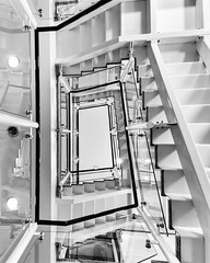 White Noise by Simon & His Camera (Simon & His Camera) Tags: white stairs bw blackandwhite lines lookingup architecture composition contrast geometric highkey indoor monochrome metal pattern simonandhiscamera urban vertical vertigo