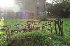 Trolleys Rusting in the Tall Grass (Itinerant Child) Tags: uk england urban sunlight david records london tower history abandoned broken water cane stairs hospital lost experiments bowie office insane fridge lab alone child state theatre decay empty hill victorian corridor cell historic system explore charlie health research abandon forgotten madness shock government radioactive isolation insanity lonely therapy ward mad care exploration operation lunatic asylum switches derelict virus operating deserted abandonment isolated decaying ue chaplin mental itinerant institution coulsdon sane urbex confinement madhouse andoned itinerantchild