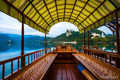 Bled - Landmarks of Lake Bled through a Pletna Boat (Yen Baet) Tags: city travel vacation reflection water sunrise boats dawn europe european view dusk eu icon tourists slovenia alpine transportation bled iconic waterscape glacial julianalps bledcastle blejskigrad veldes stmartinsparishchurch pletnaboats uppercarniola yenbaet assumptionofmarypilgrimagechurch burgveldes