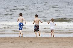 Tentative. Formby beach (Ianmoran1970) Tags: sea england beach boys water girl surf paddle wave run wash tentative splash formby ianmoran ianmoran1970