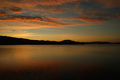 Loch Lomond Sunrise (Ed Thuell) Tags: red sky mountains reflection water clouds sunrise landscape scotland scenery loch lomond trosachs