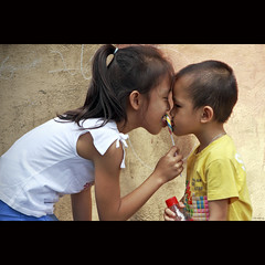 Sweet candy (-clicking-) Tags: life childhood children asia child candy touch innocent streetphotography streetlife vietnam innocence moment lovely sweetcandy vietnamesechildren colorphotoaward