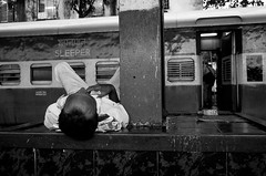 sleeper (streetwrk.com) Tags: street travel people bw india monochrome train blackwhite track tracks streetphotography stranger trainstation sw streetogs streetwrk