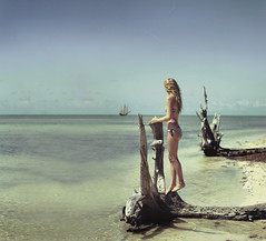 Fantasies On Open Seas (Izzy Guttuso) Tags: ocean sky beach girl 50mm boat ship florida surrealism horizon surreal driftwood shore f18 floridakeys pirateship