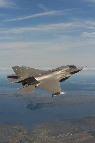 An F-35B tests flying with missiles.