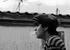 Portrait of a great friend. (Angelo G.I.O.) Tags: roof friends portrait bw monochrome outdoors 50mm nikon asia bokeh bangkok cigarette smoke smoking chilling future d3000 khlongsan nikond3000
