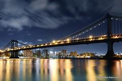 Bridges (Rafakoy) Tags: nyc newyorkcity longexposure bridge light sky cloud ny reflection water skyline architecture brooklyn night clouds digital reflections lights cityscape cloudy manhattan bridges manhattanbridge eastriver 2012 afsnikkor2470mmf28ged nikond800
