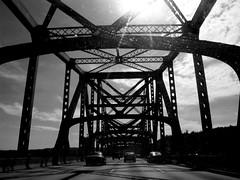 ohio bridge (frankieleon) Tags: road travel sky blackandwhite bw sun cars interestingness interesting bestof steel roadtrip cc creativecommons interstate traveling popular ohioriver ohiobridge frankieleon
