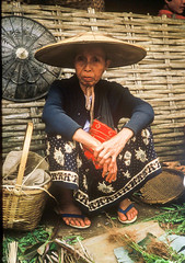 Market seller in Northern Burma (Never.Stop.Searching.) Tags: burma bamboohat lady market sarong seller