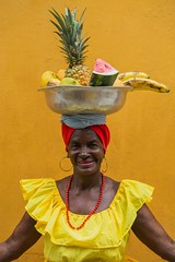 fruitful (_Maganna) Tags: cartagena fruits fruit yellow wall woman seller vendor street travel colombia lanegra outside portrait people food