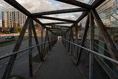 Going down (modestmoze) Tags: city vilnius lithuania buildings glass reflection reflective august summer 2016 500px grey white blue sky brown yellow shadows girl clouds one walking middle inthemiddle railings metal black constructions path down going moving street road bricks tiles lines cars day sunny
