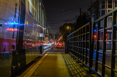 church street platform (pbo31) Tags: sanfrancisco california nikon d810 color september 2016 summer boury pbo31 bayarea night dark lightstream motion roadway motionblur muni churchstreet platform bus missiondistrict castrodistrict infinity black gate reflection depthoffield