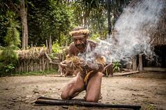 Fire Making (tehhanlin) Tags: indonesia papua westpapua irianjaya wamena jayapura nusantara sony a7r2 a7rm2 humaninterest tribe thedanis sukudani portrait pigfeast earthoven ngc