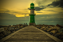 the dawning light (bocero1977) Tags: lighthouse warnemnde landscape water germany mood outdoor balticsea stones light night blue path ocean shore rocks way dawn autumn sky green atmosphere colors clouds maritim