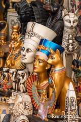 Cairo, Egypt. Ornate gold painted busts and statue replicas of Ancient Egyptian Pharos and religious figures for sale in the outdoor bazaar/ flea market Khan el-Khalili in Cairo. Pictured here are figures of Egyptian royalty Tutankhamen, Nefertiti and Cle (Remsberg Photos) Tags: africa cairo middleeast egypt world travel sightseeing tourist photography desert egyptian bazaar market purchase buy sell colorful culture barter fleamarket streetmarket outdoor gold busts figures religion ancientegypt gods cat royalty ornate tutankhamun nefertiti anubis cleopatra isis goddess egy
