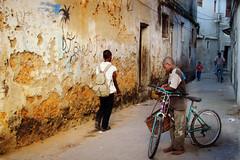 Zanzibar ... l'isola che c' ... (Augusta Onida) Tags: zanzibar stonetown tanzania africa bicicletta bike bici muro wall street via vicolo people heritage patrimoniounesco